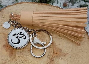 Hand-made wheat genuine leather tassel, stainless steel keychain and clip, and 316L stainless steel magnetic locket with engraved heart for diffusing your favorite oils, accented with an ō charm