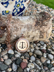 Scales of Justice rose gold locket