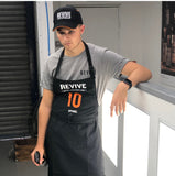 REVIVE detailer's apron, black with orange/white REVIVE logo