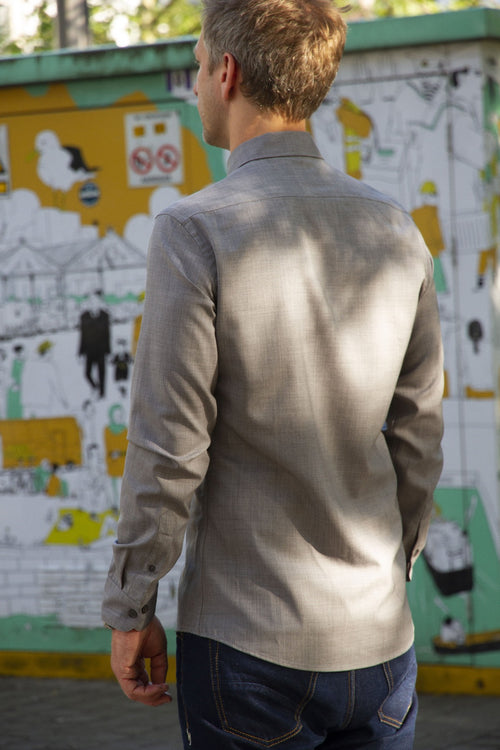 backside of men wearing merino wool shirt in grey ottoman