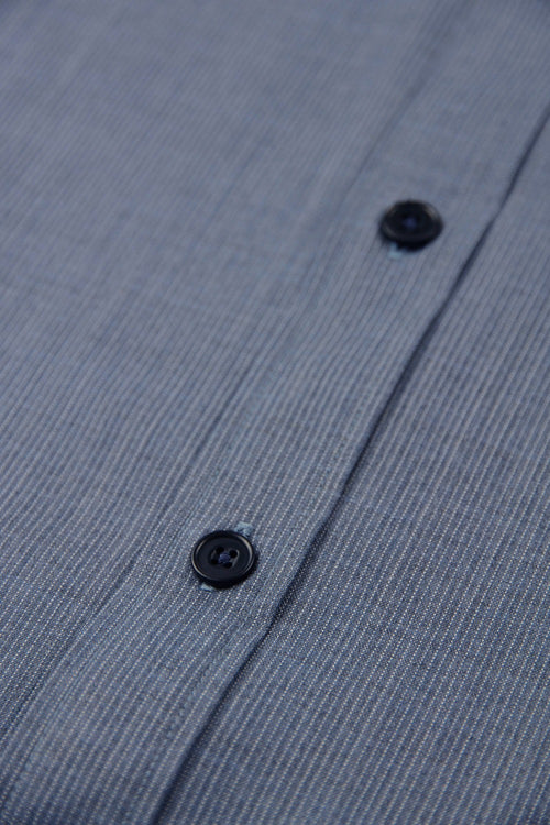blue corrozo buttons on merino wol shirt