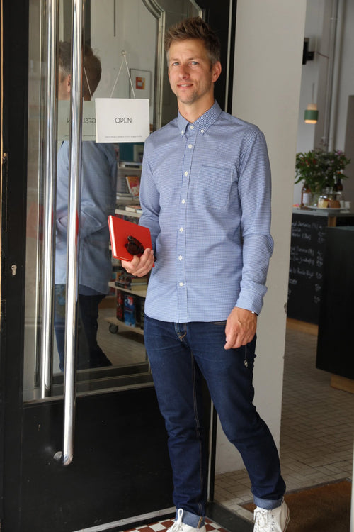 Wolk - man wearing a merino button down shirt in blue gingham and long sleeves