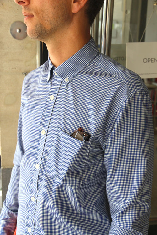 Wolk - detail of chest on man wearing a merino button down shirt in blue gingham color