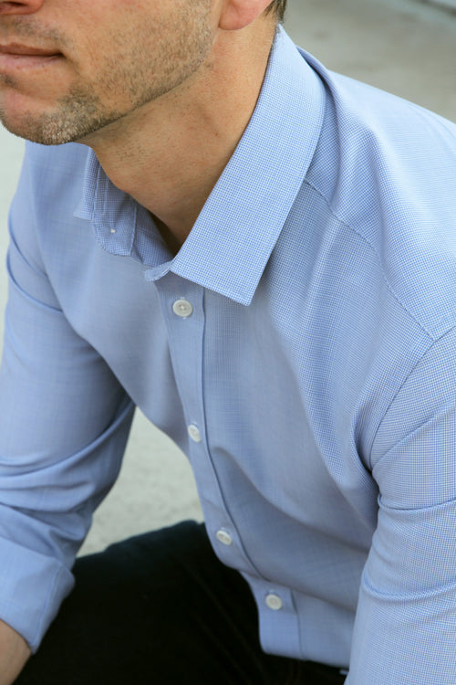 Wolk - detail of man wearing 100% merino wool shirt in light blue mini houndstooth