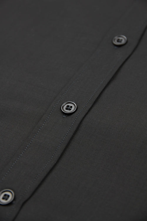 black corozo buttons on black merino wol fabric