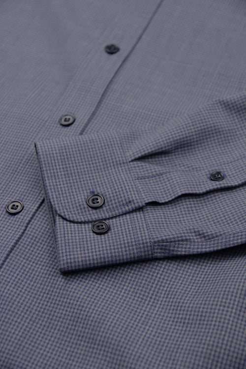 cuff detail of merino wool shirt in grey navy mini gingham and corozo buttons
