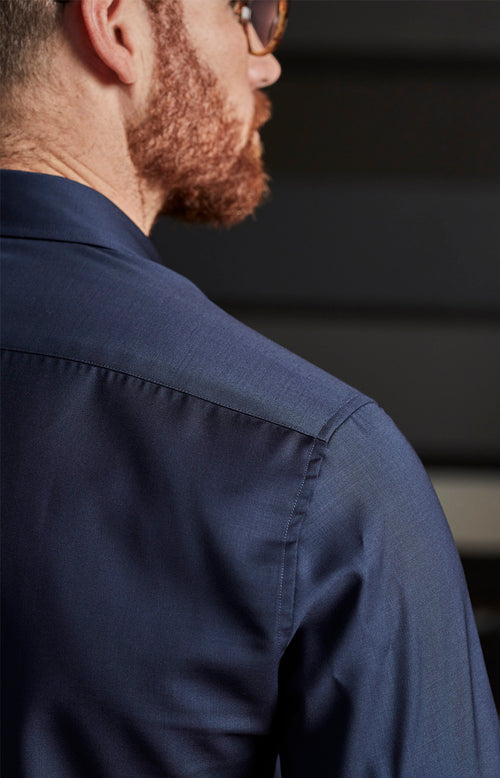 backside of man wearing merino wol shirt in navy color