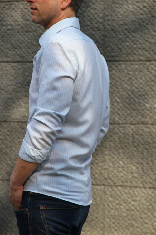 side view of men wearing merino wol shirt in light blue pinstripe