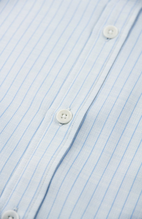 White corrozo buttons on merino shirt in light blue pinstripe