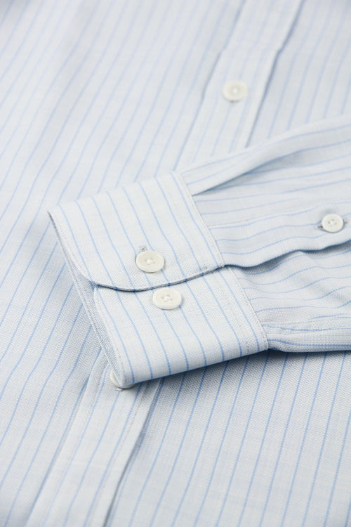 cuff detail off a merino shirt from Wolk with light blue pinstripes