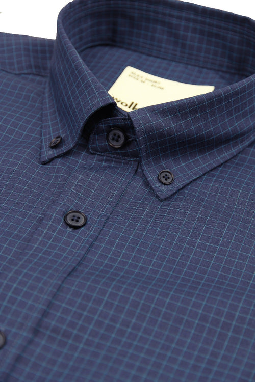 button down collar on navy blue merino shirt with light blue graph check and corozo buttons