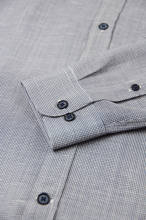 cuff detail of a merino wool and linen shirt from Wolk in dark navy houndstooth