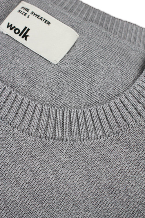 Wolk label on merino wool sweater in light grey melange color