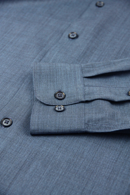 cuff detail of a navy coloured merino wool shirt from Wolk