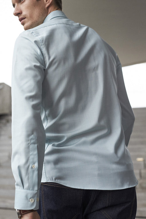 Wolk - Backside of men wearing bottom up shirt with long sleeves in aqua stripe