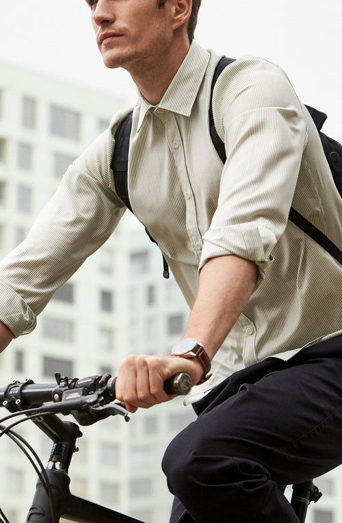 man on bike wearing a Wolk merino wool shirt in black stripe with long sleeves