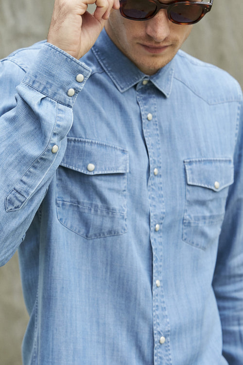 Wolk- man wearing Tencel denim shirt in washed indigo color