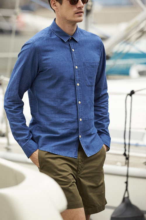 Man wearing blue indigo dyed linen shirt with chest pocket