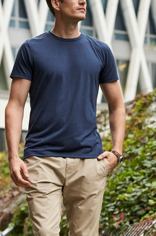 Wolk- man wearing durable Merino T-shirt in navy blue color and round neck made in Europe