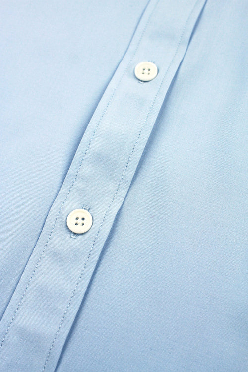 light blue merino wool shirt from Wolk with white corozo buttons