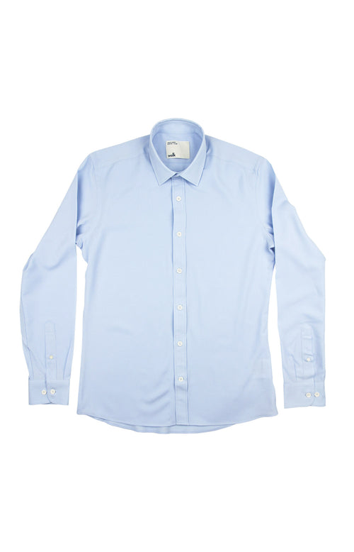 Packshot of a light blue merino wool shirt from Wolk