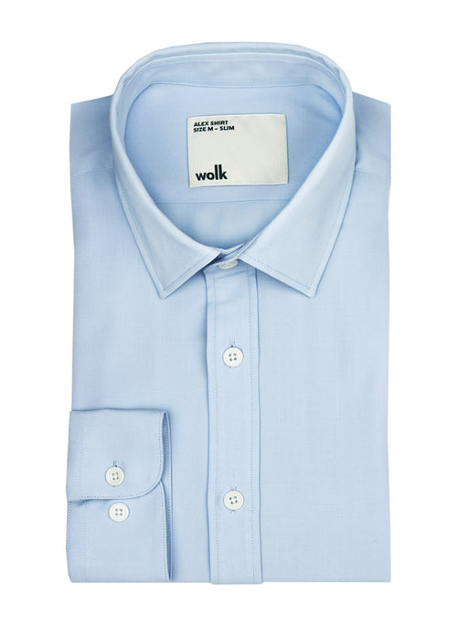 Folded light blue merino wool shirt from Wolk