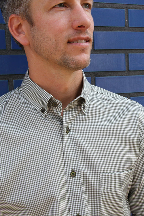 Wolk - close up of man wearing merino shirt with button down collar in olive gingham