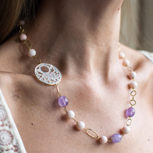 18ct Gold Mother of Pearl fancy cut out, Rose Coral bead and Silky Amethyst Necklace Asymmetrical pattern with the Mother of Pearl cut out positioned on the collarbone.  This necklace is hand made an features fancy round, oval and square links. 52cm necklace 18ct yellow gold