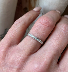 18ct white gold diamond eternity ring set with seven round brilliant cut diamonds. 0.18ct in total. G colour. VS clarity. 2.5mm diameter . This ring is suitable as a wedding band or eternity ring. Size M Other sizes by special order.