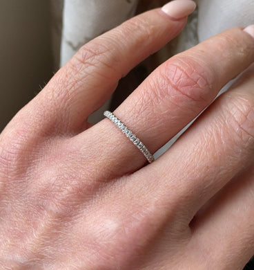 18ct white gold diamond eternity ring set with nineteen round brilliant cut diamonds. 0.12ct in total. G colour. VS clarity. 2mm diameter . This ring is suitable as a wedding band or eternity ring. Size O Other sizes by special order.