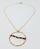 The Cera Necklace - Garnet and Circle Pendant