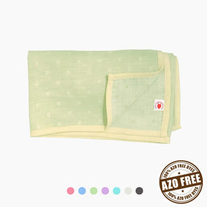 Pokka Kids lime polka dot GOTS certified organic cotton blanket for use as a stroller cover, or nursing cover