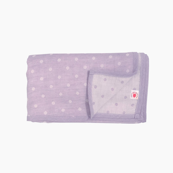 Folded purple polka dot GOTS certified organic cotton blanket for use as a stroller cover, or nursing cover