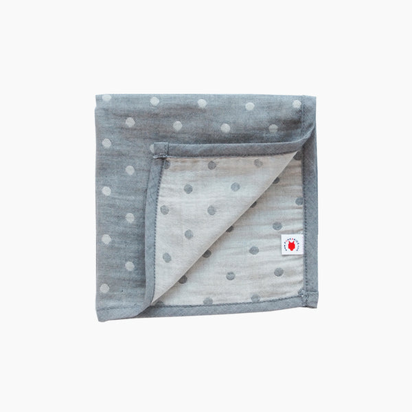 Folded gray jacquard GOTS certified organic cotton hanky for use as a  wash cloth, burp cloth, bib, scarf or security blanket