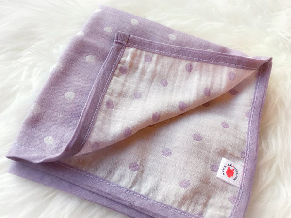 Folded purple GOTS certified organic cotton hanky for use as a wash cloth, burp cloth, bib, scarf or security blanket