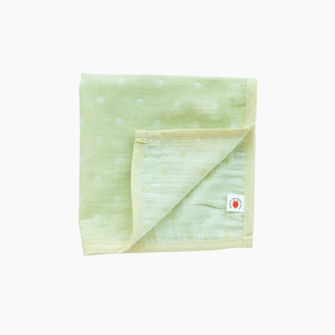 Folded lime GOTS certified organic cotton hanky for use as a wash cloth, burp cloth, bib, scarf or security blanket