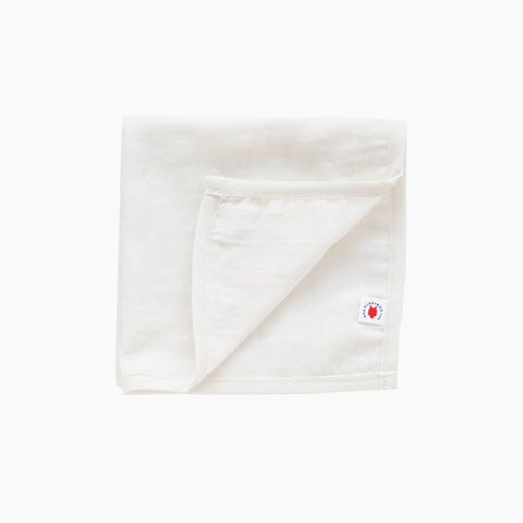 Folded dye free GOTS certified organic cotton hanky for use as a wash cloth, burp cloth, bib, scarf or security blanket
