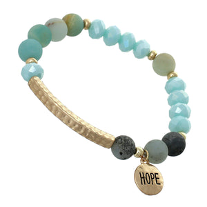 "Sky Blue, Glass And Earth-tone Mini Beaded Stretch Bracelet ""Hope"" On Textured Gold-toned Round Accent"