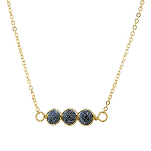 Gold Tone Chain Necklace With Three Round Black And White Marble Toned Stones In Wire Pendant