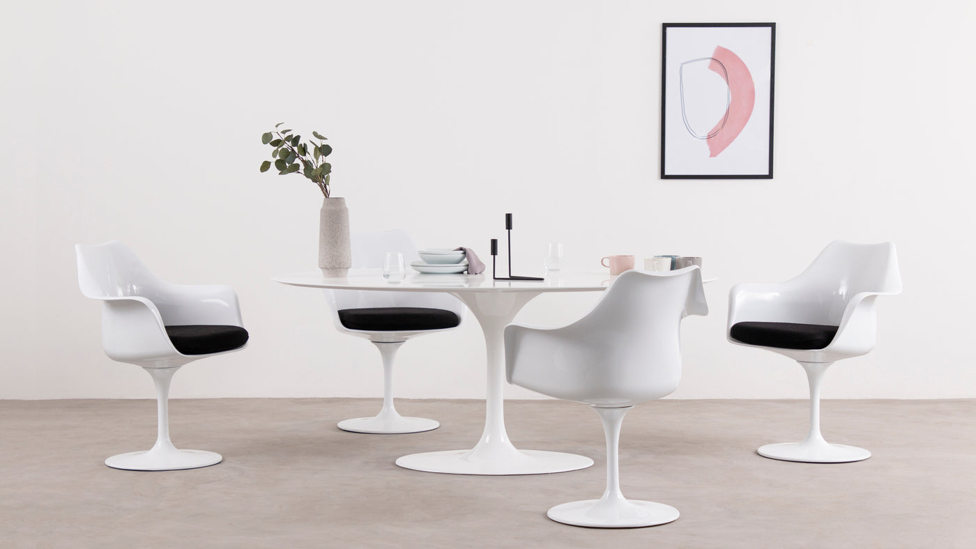 A standout seating solution|Ideal as a standalone piece, or the perfect complement to the coordinating Tulip Table, this iconic design can be found in homes and businesses around the world. As a bestselling piece of the wildly popular collection, the Tulip Armchair is sleek, sophisticated and comfortable. Saarinen didn't just perfect the chair's form; he also prioritized function and comfortability.