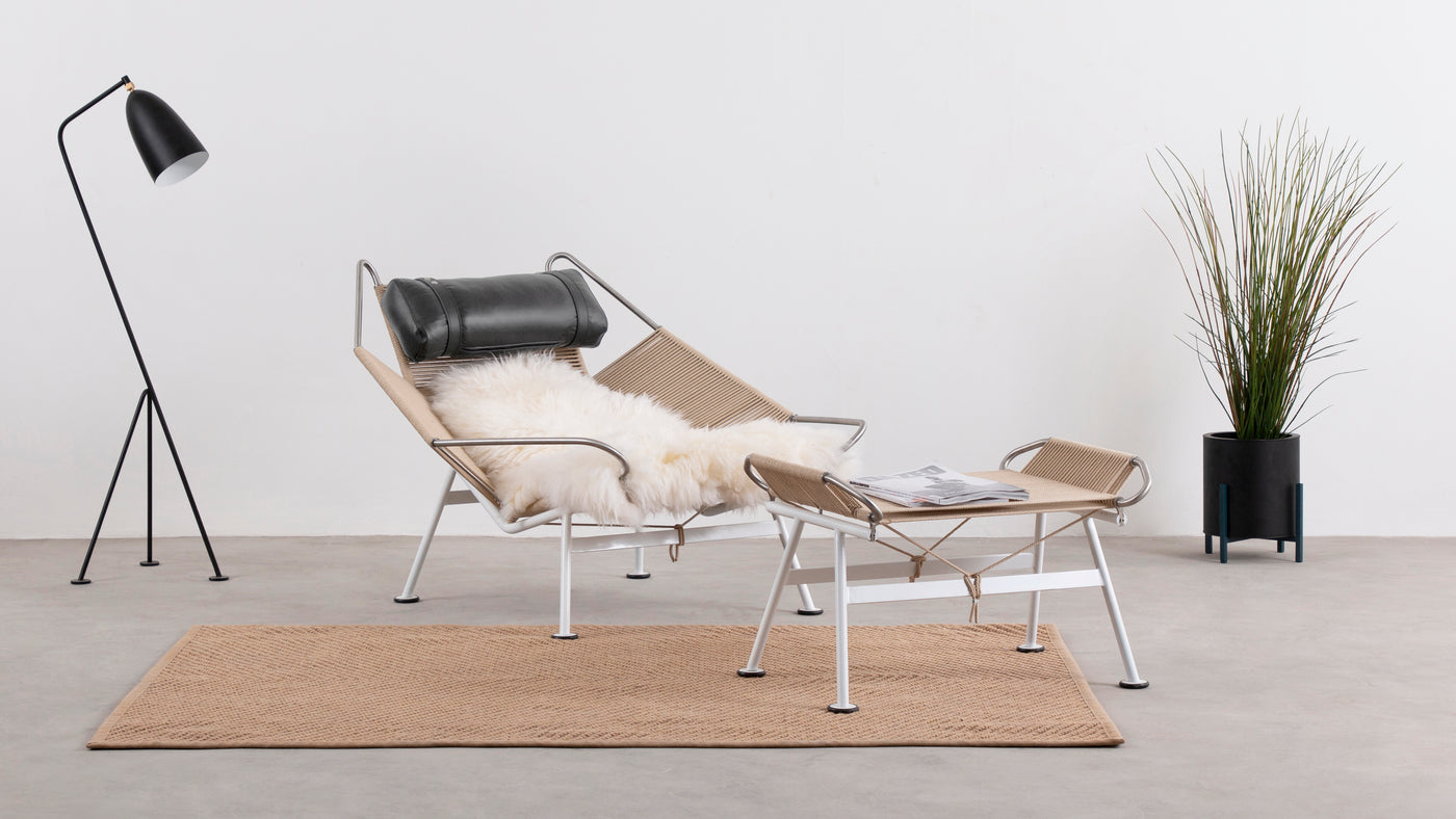 Contemporary inspiration|Although it was first introduced to the world in the early 1950s, the Flag Halyard Chair continues to inspire with its unique, contemporary features. Wegner began dreaming up this fun and functional design during a family trip to the beach.