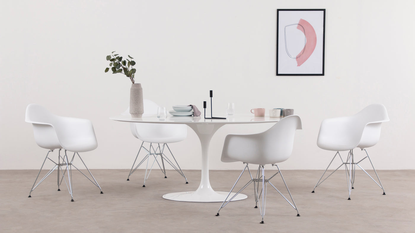 The comfort factor|While the designers of this chair certainly prioritized form and durability, the chair was designed to be used on a daily basis. With its ergonomic deep seat and carefully placed armrests, this chair is surprisingly comfortable, making it perfect for the kitchen, dining room or conference room.