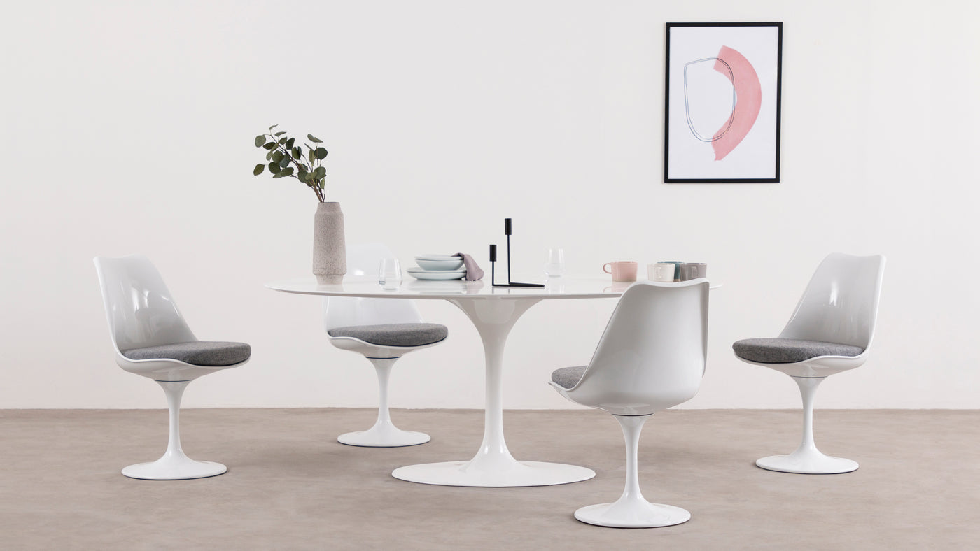 Comfort revolutionized|This stunningly sophisticated chair is the perfect addition to any stylish space. It's incredibly comfortable, thanks to its curved shape and padded cushion, making it ideal for prolonged sitting. A great alternative to the traditional office chair, the Tulip Chair includes a built-in swivel feature, adding to its versatility.