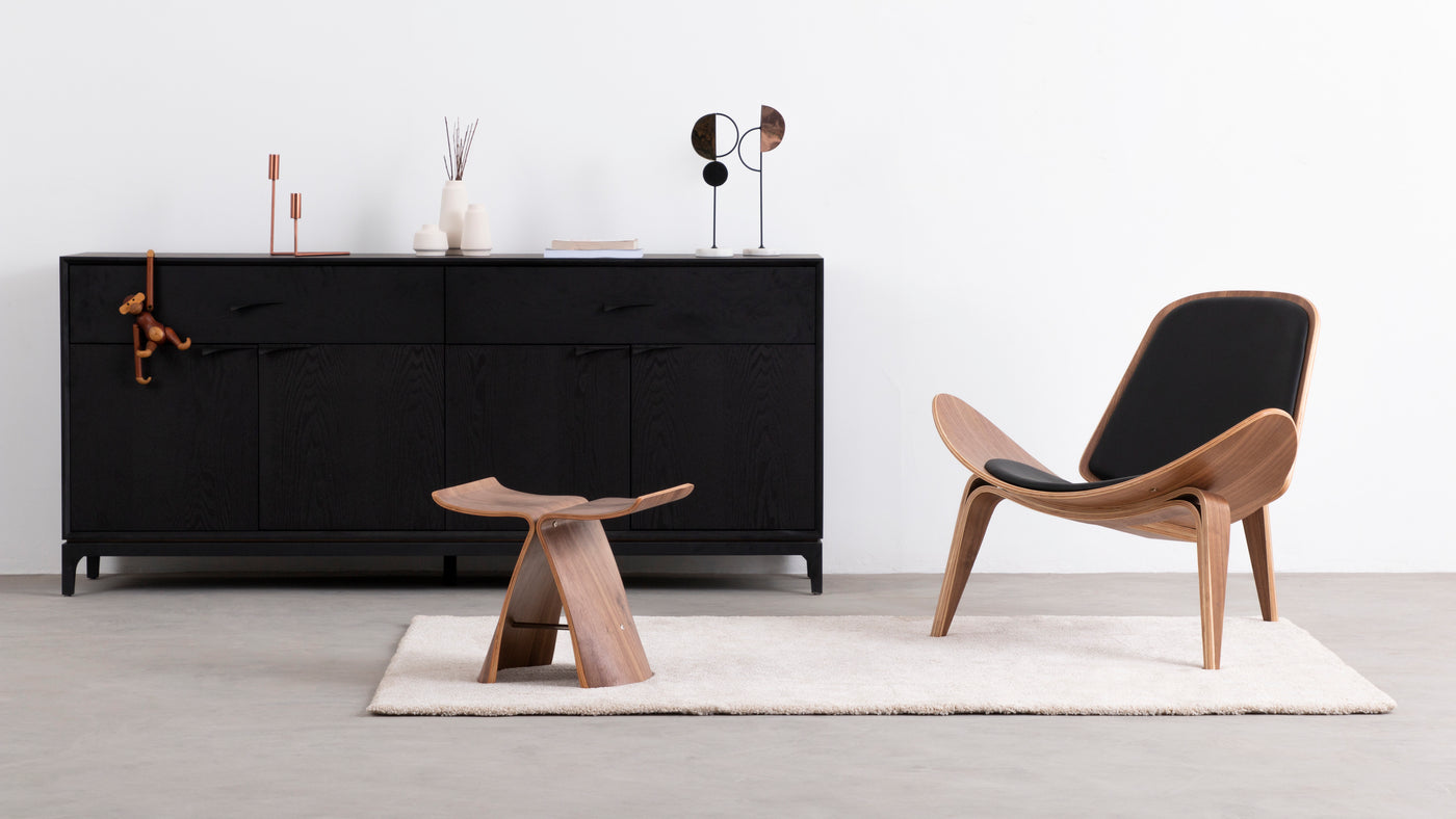 Sleek and contemporary|Enjoy impromptu seating without compromising style with this Bent Butterfly Stool. Brushed stainless steel and walnut wood combine, fusing impeccable design elements with sturdy construction.