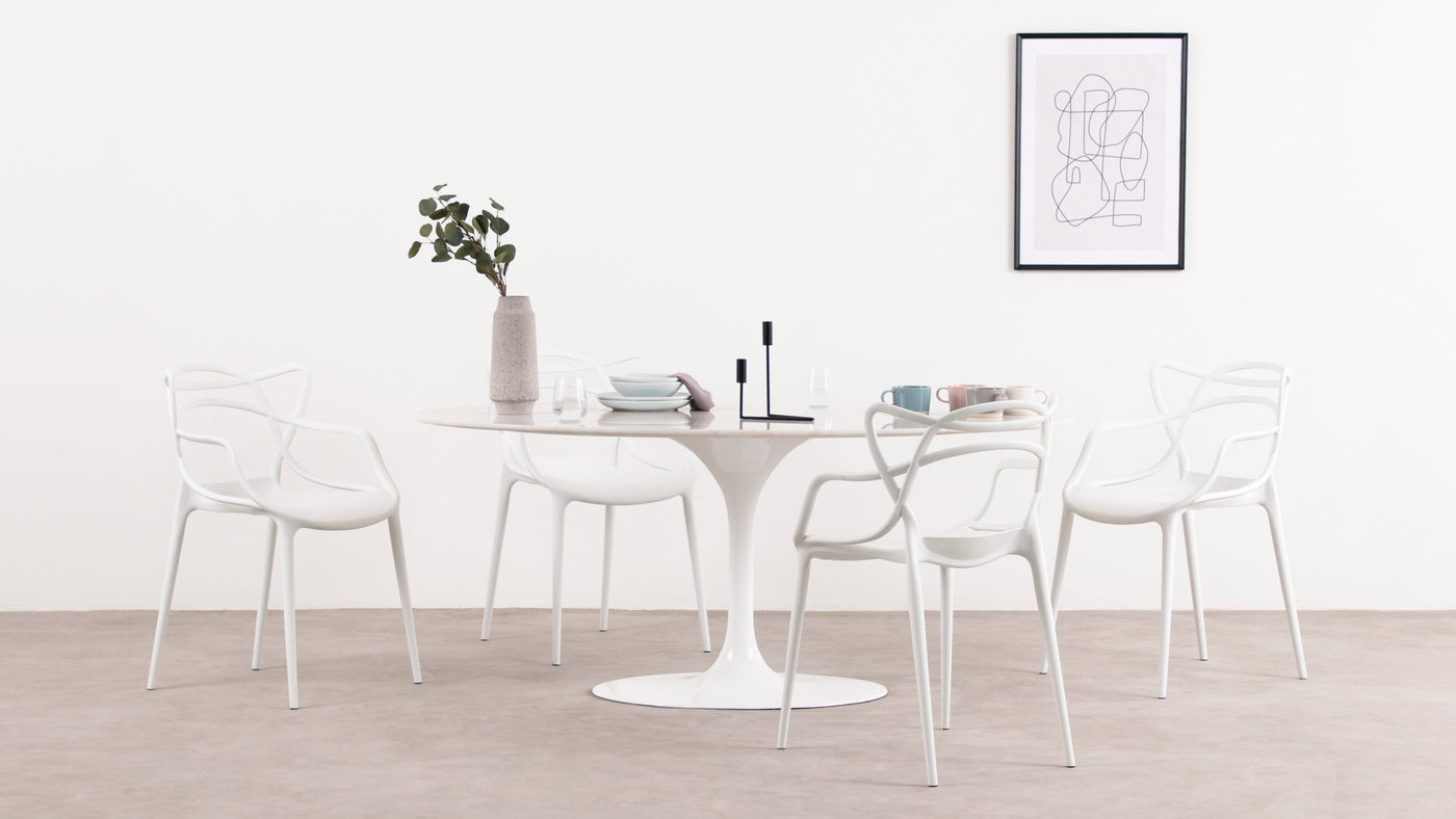 Marvelous marble|This stylish iteration of the Tulip Dining Table is handcrafted from only the finest materials, including a stunning marble tabletop that's just as beautiful as it is functional.