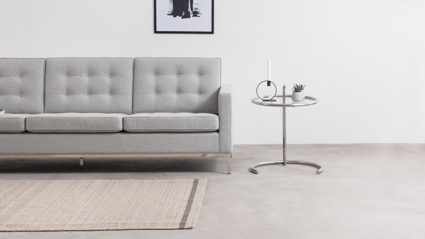 Elevate your space|Sleek and sophisticated, the E1027 Coffee Table is crafted from tubular steel and shatter-resistant thick glass. The combination of materials adds to its timeless elegance.