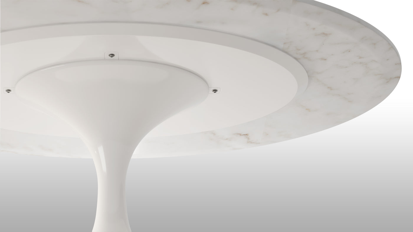 Built for longevity|In addition to being a perfectionist, Saarinen was insistent on using only the highest quality materials. From the meticulous construction to the hardwearing aluminum base and marble tabletop, this piece is built to last a lifetime—and beyond.
