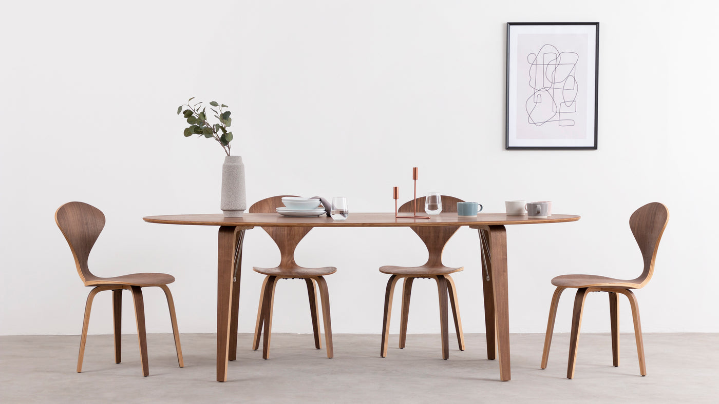 Simplistic, sophisticated dining|Understated elegance and functionality unite to create this simplistic yet sophisticated dining table. The sleek curves and natural wood bring an essence of whimsy and grace to virtually any space.