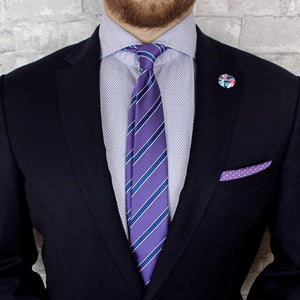 guy wearing a purple and blue lapel pin and purple polka dot pocket square - Oxford Square