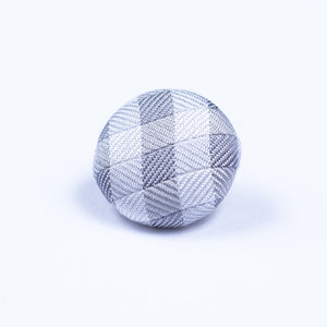 gray and white lapel pin - Oxford Square